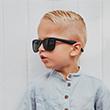 cute kid wearing overnight sunglasses
