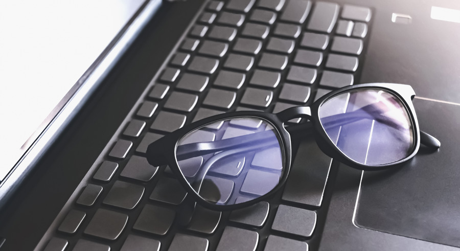 eyeglasses on keyboard photo